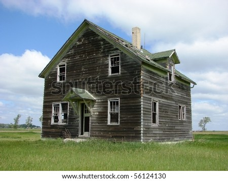 abandoned weathered buildings - stock photo