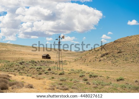 Abandoned western homestead with windmill