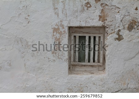 Abandoned window on an worn wall - stock photo