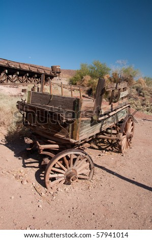 Abandoned wooden coach in american ghost town - stock photo