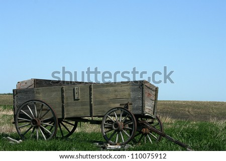Abandoned wooden grain wagon in a field outside of Morden, Manitoba, Canada - stock photo