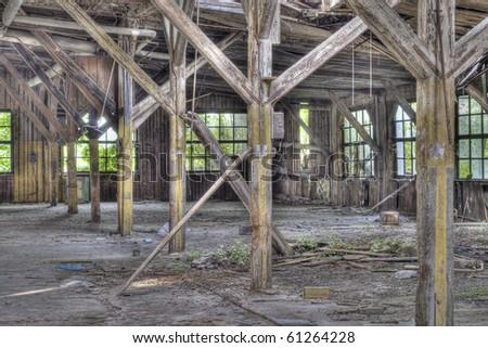 Abandoned wooden industrial building with broken windows - stock photo