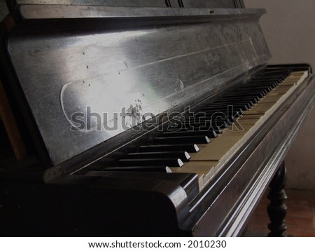 Abandonmed piano full of dirt