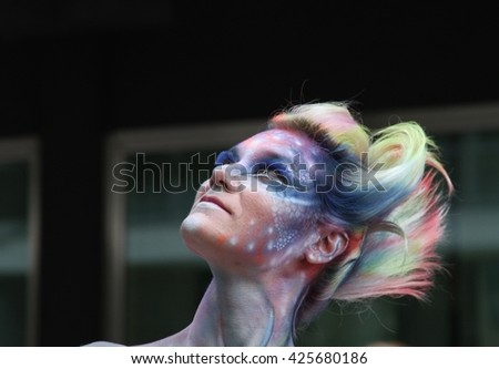 ABANO TERME, ITALY - MAY 8: Young models and 20 europeans body painters at work for the Bodypainting Festival, the 4th festival (public and free) of body painting in Abano Terme, Italy. May 8, 2016. - stock photo
