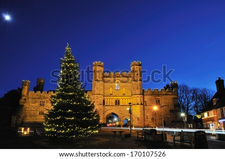 Abbey at Battle, East Sussex, South-East England, illuminated at Christmas time with moonlight - stock photo