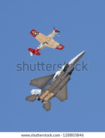 ABBOTSFORD, CANADA - AUGUST 14:  P-51 Mustang & F-15 perform aerial flyby maneuver over the skies at the Abbotsford International Airshow on August 14, 2010 in Abbotsford, Canada - stock photo
