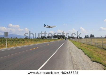 ABBOTSFORD - JULY 31, 2016: Westjet, a Canadian National airliner, approaches the airport in Abbotsford, British Columbia on July 31, 2016.