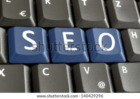 Abbreviation SEO written with blue keyboard buttons. - stock photo
