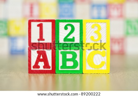 ABC and 123 Spelled Out in Alphabet Building Blocks - stock photo