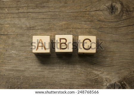 ABC building blocks on wooden background - stock photo