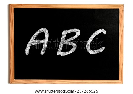 ABC Chalk Text on Chalkboard with Wooden Frame Isolated on White - stock photo