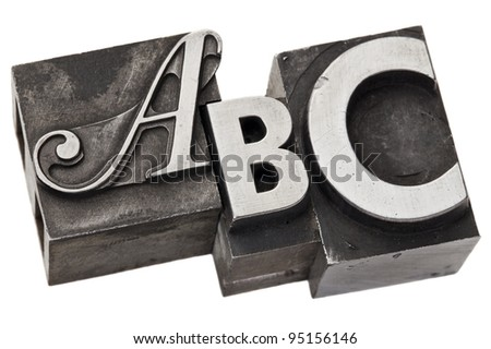 abc - first three alphabet letters in vintage letterpress metal type, isolated on white - stock photo
