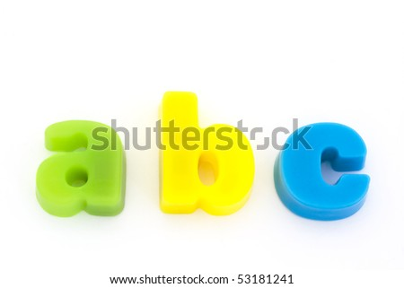 abc green yellow and blue magnetic letters on white - stock photo