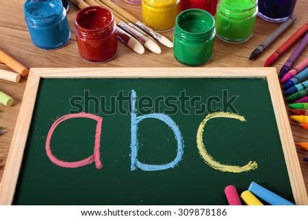 ABC simple alphabet preschool reading and writing lesson on blackboard - stock photo