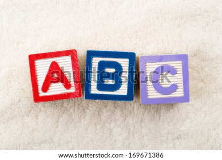 ABC toy block with towel background - stock photo