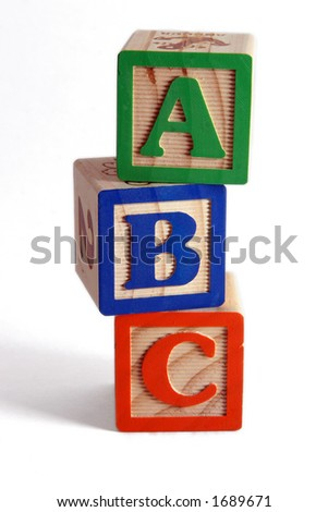 ABC wooden blocks stacked vertically. - stock photo