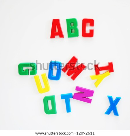 ABC written on fridge door with fridge magnet alphabet letters. - stock photo