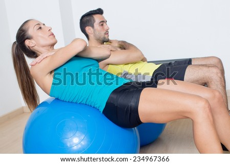 Abdominal exercise on med ball - stock photo