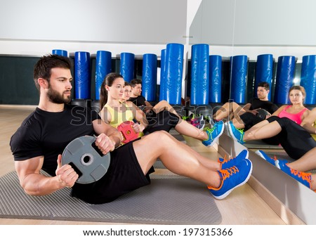 Abdominal plate training core group at gym fitness workout - stock photo