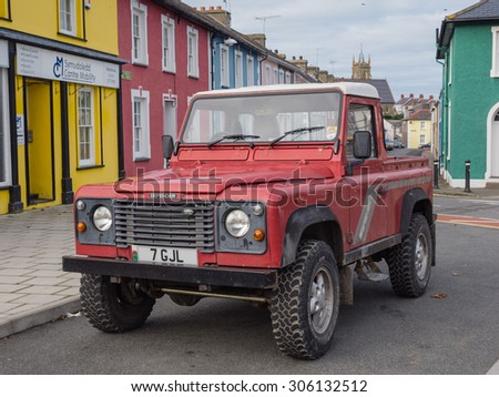 ABERAERON, WALES - 5 OCT. 2013: A Landrover parked in a street in a Welsh town. Landrover jeeps are very popular in rural Wales since the brand was developed here in 1948 - stock photo