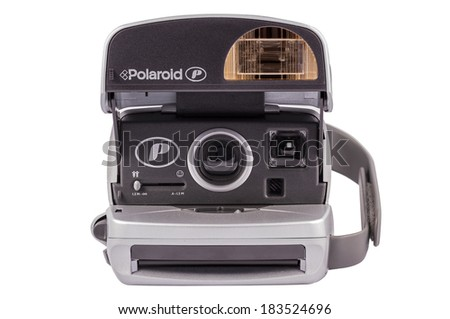 ABERFELDY, SCOTLAND - MARCH 16, 2014: Silver Polaroid P-CAM 600 camera for instant photos from the year 1990-2000  - stock photo