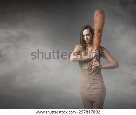 aborigine woman with big club on hand