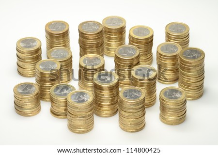About 300 euro coins lying on several stacks.