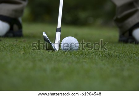 About to hit golf ball - stock photo