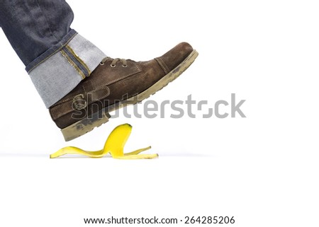 About to slide with a banana peel - stock photo