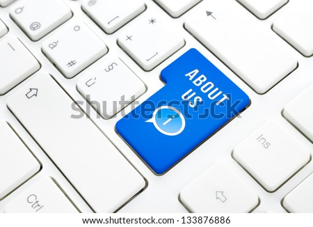 About us concept, blue enter button or key on white keyboard - stock photo