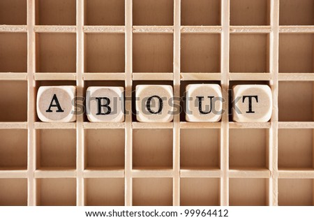 About word construction with letter blocks / cubes and a shallow depth of field - stock photo