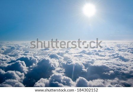 Above the clouds, the sky and the sun