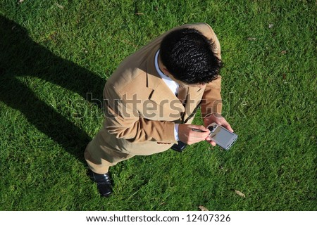Above view of a businessman looking to his pocket pc - stock photo