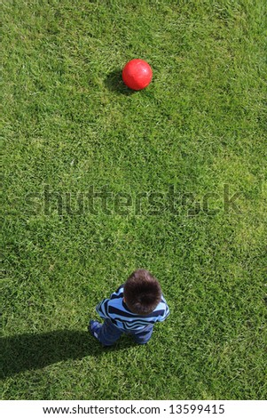 Above view of a little boy ready to play football - stock photo