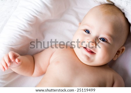 Above view of adorable baby boy having fun in his cradle - stock photo