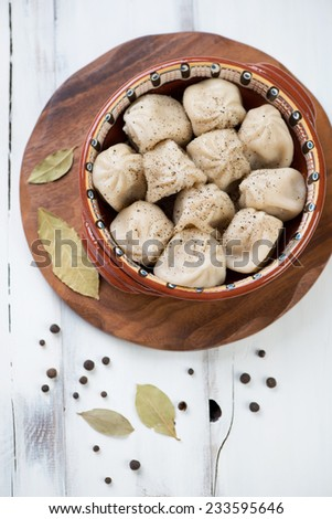 Above view of boiled georgian khinkali with black pepper - stock photo