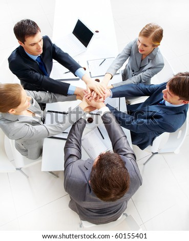 Above view of business people with their hands on top of each other - stock photo