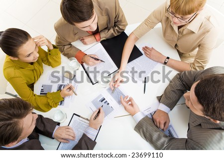 Above view of communicating business partners during meeting - stock photo