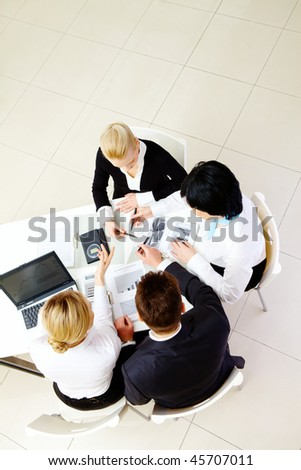 Above view of confident business partners interacting at meeting