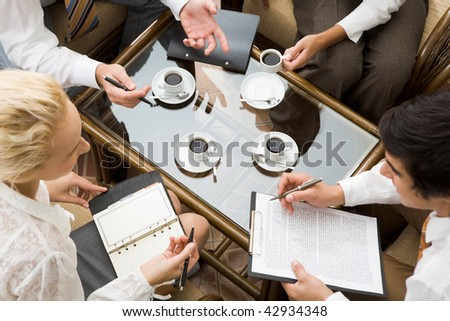 Above view of confident businesspeople planning work in the room - stock photo