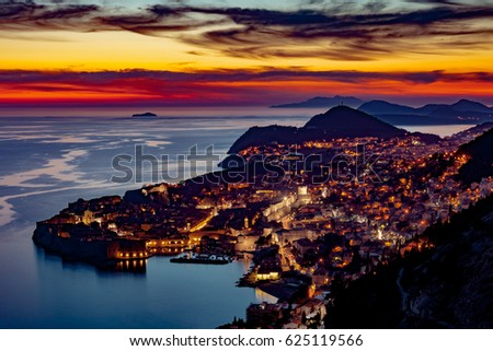 Above view of Dubrovnik at dusk with sunset sky
