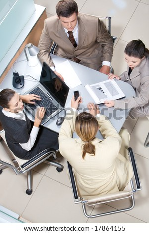 Above view of executive people communicating during meeting - stock photo