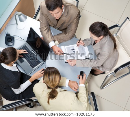 Above view of executive people interacting at corporate meeting - stock photo