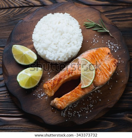 Above view of fried trout steak served with rice, close-up - stock photo