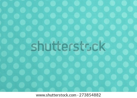 Above View of Polka Dot Woven, Cotton Fabric for a Colorful, Monochromatic Cyan, Teal or Turquoise Background Template, use horizontal or vertical with room or space for text, copy, words.  Photo - stock photo