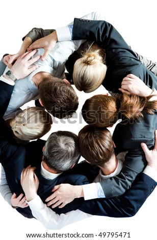 Above view of several business partners embracing each other and making circle - stock photo