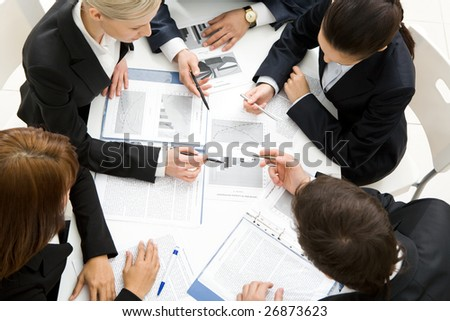 Above view of successful workteam discussing new plan at meeting - stock photo