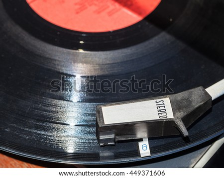 above view of vinyl record in old turntable close up