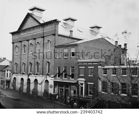 Abraham Lincoln's assassination took place in Ford's Theatre on April 14, 1865. Photo shows the post-assassination scene with guards posted at entrance and crepe draped from window. - stock photo