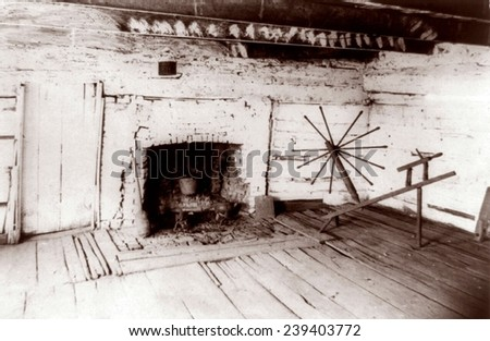 Abraham Lincoln's birthplace, a log cabin in Kentucky with fireplace and the spinning jenny of Mrs. Lincoln. 1891 photo. - stock photo
